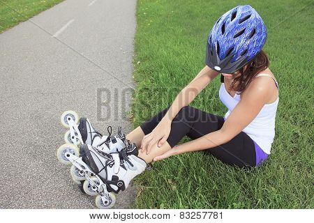 A Roller skating girl in park rollerblading on inline skates.