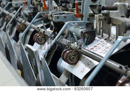 Newspaper production line in print shop