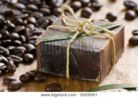 Handmade coffee scented soap on wooden background poster