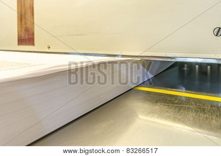 modern paper guillotine in print house
