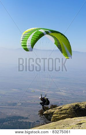 Paraglider prepareing to take off from a mountain