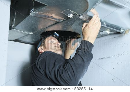 A ventilation cleaner check for dust on it. poster