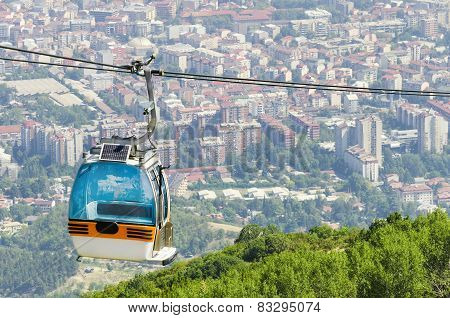 Cable car on a mountain and the city Skopje in the background