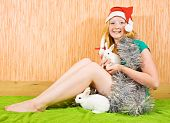 teenager girl in new year decoration with two pet rabbits poster