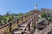 Stairs to statue of Jesus Christ at Garajau in Funchal Madeira Island poster