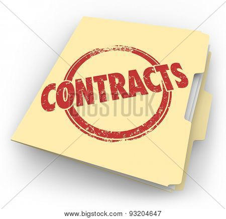 Contracts word  stamped on a manila folder full of agreements, closed sales and deals with clients or customers