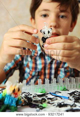Preteen Hansome Boy Show  The Result Of His Rainbow Loom Hobby Panda