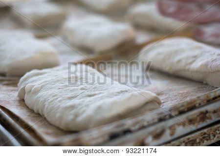 Close Up Of Uncooked Ciabatta Bread Rolls