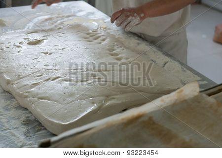 A Flat Of Raw Ciabatta Bread