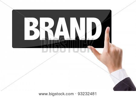 Businessman pressing button with the text: Brand