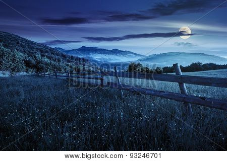 Fence On Hillside Meadow In Mountains At Night