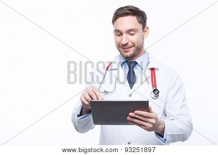 Handsome doctor holding the laptop