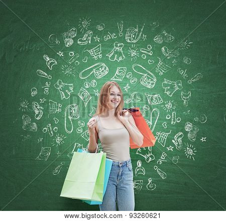 A Happy Young Woman With The Colourful Shopping Bags From The Fancy Shops. Shopping Icons Are Drawn