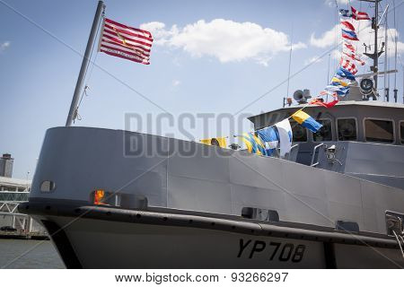 NEW YORK - MAY 22 2015: The traditional First Navy Jack Flag that says Dont Tread On Me waves from the bow of a US Naval Academy Yard Patrol Craft moored at Pier 86 during Fleet Week NY 2015.