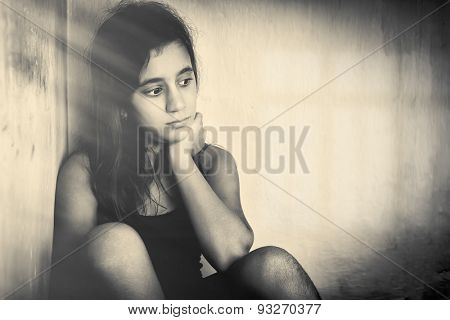 Monochrome portrait of a sad and lonely girl (with space for text)