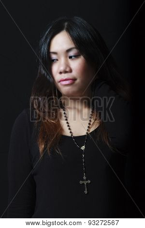 Pensive Asian Female