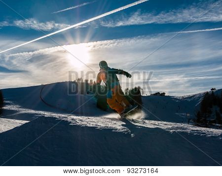 Freestyle Snowboarder With Helmet In Snowpark
