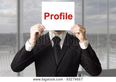 Businessman Hiding Face Behind Sign Profile