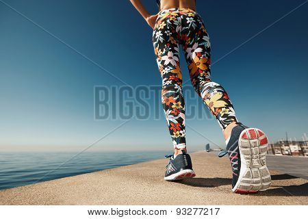 Runner Woman Feet Running On Road Closeup On Shoe. Female Fitness Athlete Jogger Workout In Wellness