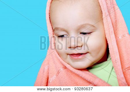 Smiling Baby Wrapped In A Pink Towel