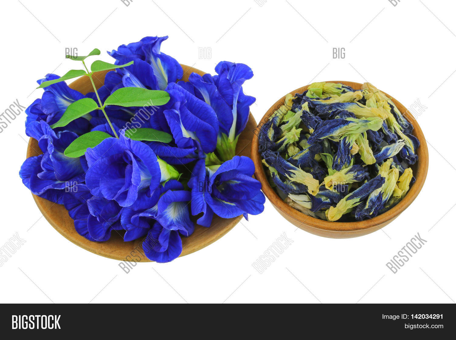 Fresh And Dried Erfly Pea Blue Flowers In Purple On Wooden Bowl Isolated