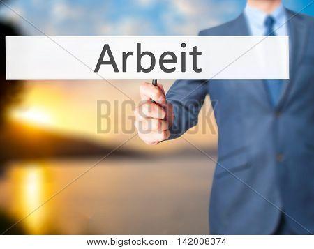 Arbeit (work In German) - Business Man Showing Sign