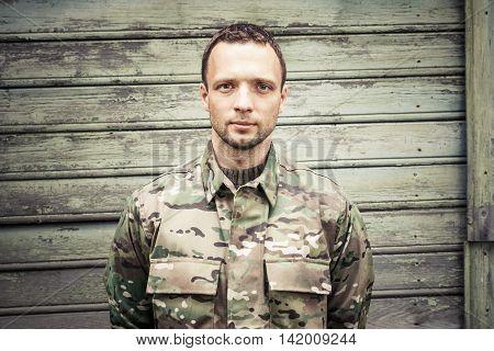 Caucasian Man In Camouflage Uniform