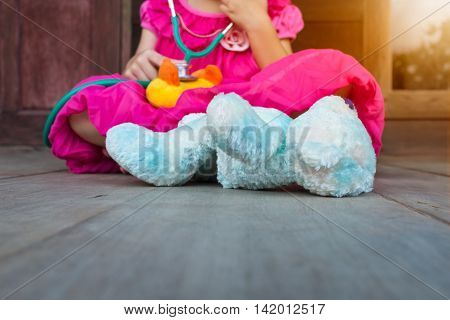 Child Playing Doctor Or Nurse With Plush Toy Bear At Home.