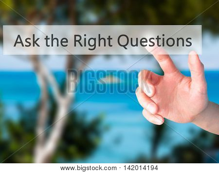 Ask The Right Questions - Hand Pressing A Button On Blurred Background Concept On Visual Screen.