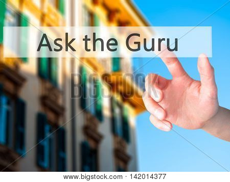 Ask The Guru - Hand Pressing A Button On Blurred Background Concept On Visual Screen.
