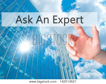 Ask An Expert - Hand Pressing A Button On Blurred Background Concept On Visual Screen.
