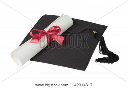 Black graduate hat and paper scroll tied with red ribbon with a bow isolated on white background