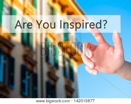 Are You Inspired ? - Hand Pressing A Button On Blurred Background Concept On Visual Screen.