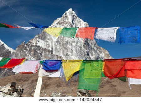 Rows of prayer flags and mount Arakam Tse sagarmatha national park trek to Everest base camp - Nepal