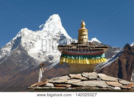 Buddhist Temple - detail of roof with mount Ama Dablam - Nepal