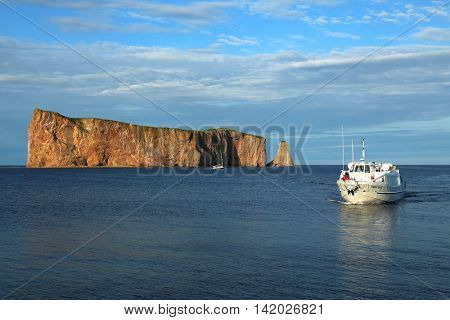 GASPESIE-QUEBEC, 2 august 2016:  Cruise on the sea to see the Rocher Perce, one of the world's largest natural arches located in water in Gaspesie, Quebec, Canada.