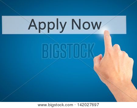 Apply Now - Hand Pressing A Button On Blurred Background Concept On Visual Screen.