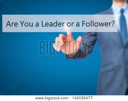 Are You A Leader Or A Follower ? -  Businessman Press On Digital Screen.