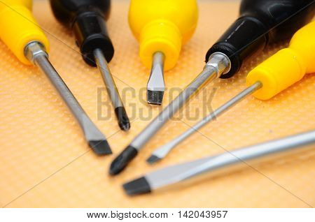 Set of screwdrivers with different  shaft types.