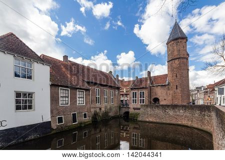 Medieval town wall Koppelpoort and the Eem river in Amersfoort Netherlands