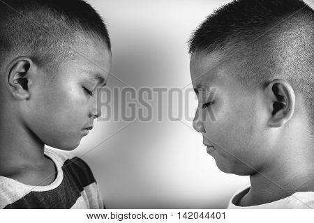 two young aisan brothers on a white background