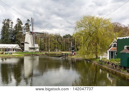 Traditional Dutch windmill in the country side of Netherlands