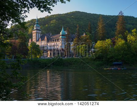 Northern front of Lillafured palace (Miskolc Hungary). Lake Hamori in foreground mountains covered with forest - background.