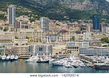 MONACO, MONACO - JUNE 17, 2015: View to the buildings and marina of Monte Carlo from the viewpoint at the Prince's Palace of Monaco (Monaco - Ville) in Monaco, Monaco.