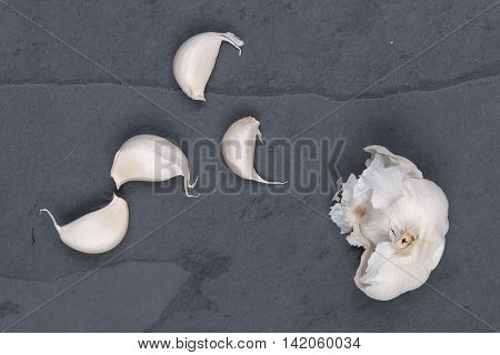 White garlic on a grey cutting board stock picture