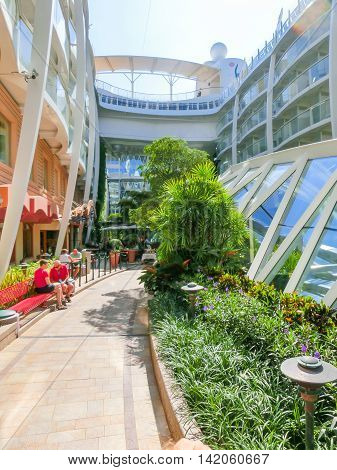 Barselona, Spaine - September 06, 2015: Royal Caribbean, Allure of the Seas sailing from Barselona on September 6 2015. The second largest passenger ship constructed behind sister ship Oasis of the Seas. Passengers sitting at Central Park