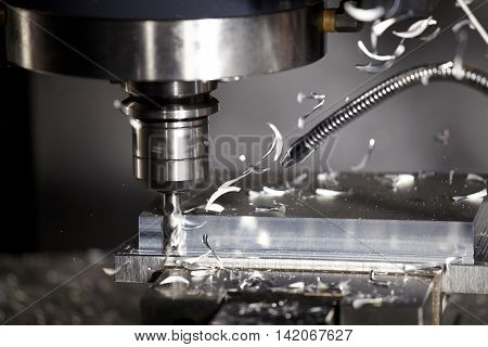 CNC drilling steel at work bit tools with parts slow motion