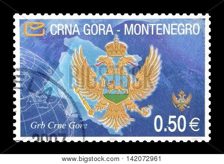 MONTENEGRO - CIRCA 2007 : Cancelled postage stamp printed by Montenegro, that shows Coat of arms and map.