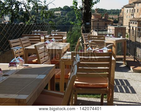 Tables and chairs of a dehors alfresco bar winery restaurant