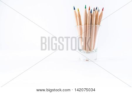 Wooden pencils in a glas, isolated on white.